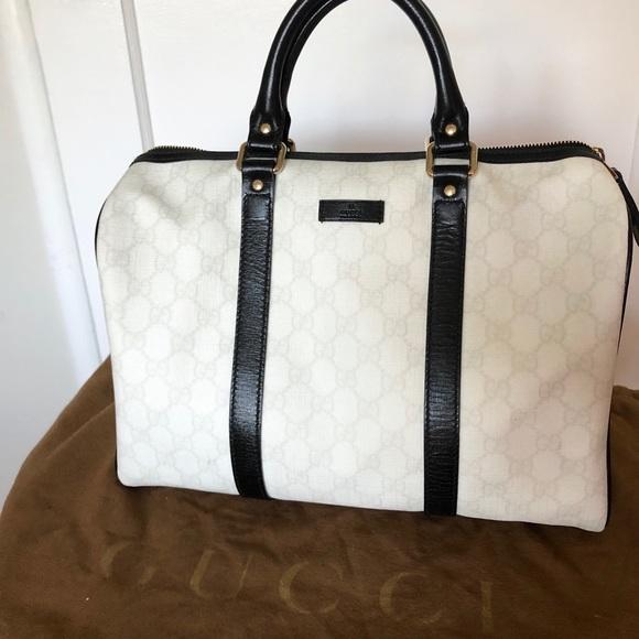 b643fb1db3a6 Gucci Handbags - Gucci White/Black GG Coated Canvas Joy Boston Bag